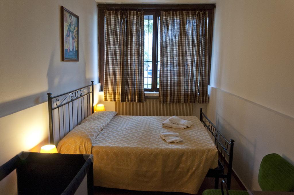 Номер в резиденции Сегаттини в Рива Дель Гарде